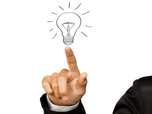 Business man hand drawing light bulb isolated on white